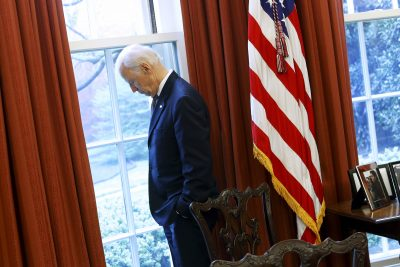 Joe Biden stands at a window looking out to the South Lawn in the Oval Office at the White House in Washington DC, 14 April 2015 (Photo: Reuters/Jonathan Ernst)