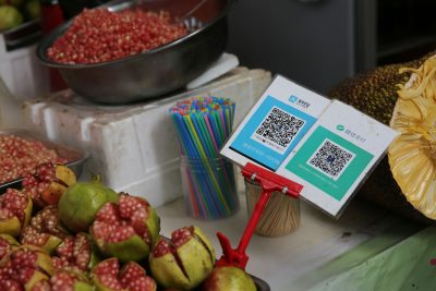 View of a QR code at a stall supported by mobile payment service Alipay of Alibaba Group, left, and WeChat Payment of Tencent at a free market in Xi'an city, northwest China's Shaanxi province, 21 August 2017 (Photo: Reuters).