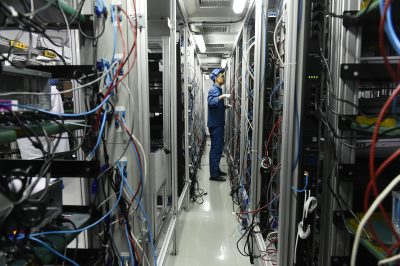A worker assembles servers on the assembly line of China's Dawning Information Industry Co., also known as Sugon, in Tianjin, China, 14 March 2018 (Photo: Reuters).