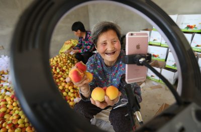 Cui Shuxia, a streamer in her eighties, selling local apricots to customers all over the country via the internet, Taipingbao village, Taiping Town, Xixian New Area, Xi'an city, northwest China's Shaanxi province, 28 May 2020 (Photo: Reuters).