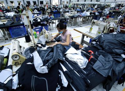 Workers sew clothing at a Vietnamese garment factory in Hung Yen, December 2020 (Photo: Aly Song/Reuters).