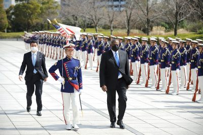 Lloyd Austin, US Secretary of Defense (R) and Japanese Defense Minister Kishi Nobuo (L) attend a review an honour guard prior the US–Japan Defense Ministers Bilateral meeting at the Japan Ministry of Defense, Tokyo, Japan, 16 March, 2021 (Photo: David Mareuil/Pool via Reuters).