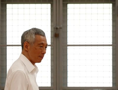 Singapore's Prime Minister Lee Hsien Loong of the People's Action Party arrives to give a speech at a nomination center ahead of the general election in Singapore, 30 June 2020 (Photo: Reuters/Edgar Su).