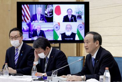 Yoshihide Suga, Japan's Prime Minister, speaks while a monitor displays US President Joe Biden, Australia's Prime Minister Scott Morrison and India's Prime Minister Narendra Modi, during the virtual Quadrilateral Security Dialogue (Quad) meeting at his official residence in Tokyo, Japan, on Friday 12 March 2021 (Photo: Reuters/Kiyoshi Ota/Pool).