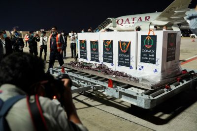 Workers offload boxes of Oxford/AstraZeneca vaccines received under the COVAX scheme, Phnom Penh International Airport, Cambodia, 2 March 2021 (Photo: Reuters/Cindy Liu).