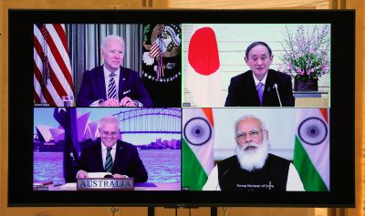 Japanese Prime Minister Yoshihide Suga (top right), US President Joe Biden (top left), Australian Prime Minister Scott Morrison (bottom left) and Indian Prime Minister Narendra Modi (bottom right) during the Quad Summit on 12 March 2021 (Photo: The Yomiuri Shimbun via Reuters/Ryohei Moriya).