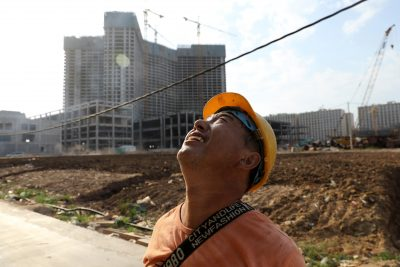 A worker stands on a construction site in Sihanoukville, Cambodia, 27 February 2020 (Photo: Reuters/Jorge Silva).