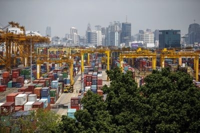 Shipping containers stand at a port in Bangkok, 30 March 2015 (Photo: Reuters/Athit Perawongmetha).