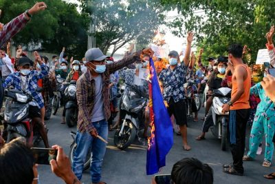 Protesters against Myanmar's junta burn the flag of the Association of Southeast Asian Nations (ASEAN), in Mandalay, Myanmar, 5 June 2021 (Photo: Reuters/Stringer).