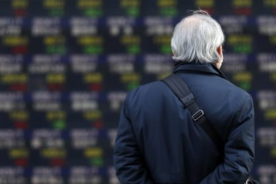 Man walks past a board showing currency exchange rates, Tokyo, 12 March 2021, (Photo: Reuters/James Matsumoto)