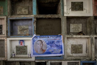 A tarpaulin bearing the face Lilibeth Valdez, the 52-year old woman who was shot and killed by a policeman off-duty, is hung on the apartment-style grave where she was laid to rest in Bagbag Cemetery, Quezon City, Philippines, 4 June 2021 (Photo: Reuters/Eloisa Lopez).
