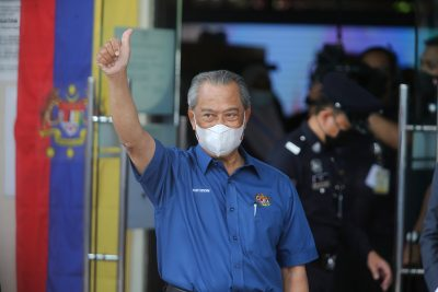 Prime Minister Muhyiddin Yassin raises a thumb on arrival at a health district office for the first dose of Pfizer-BioNTech COVID-19 Vaccine in Putrajaya (Photo: Calvin Pan/SOPA Images/Sipa USA via Reuters).