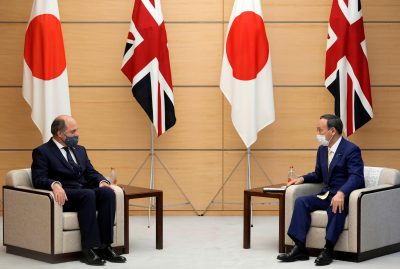 Britain's Defence Secretary Ben Wallace listens to Japan's Prime Minister Yoshihide Suga at the start of their meeting at the prime minister's official residence in Tokyo, Japan, 20 July 2021. (Franck Robichon/Pool via REUTERS)