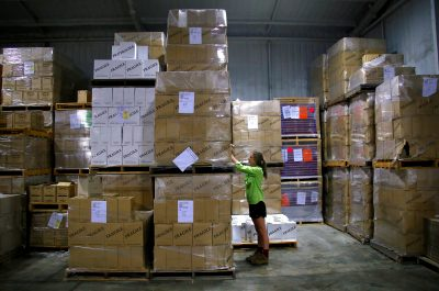 Sarah Drayton, Petersons Winery Warehouse Manager, checks boxes of wine for export in the Hunter Valley, Sydney, Australia, 14 February 2018 (Photo: Reuters/David Gray).