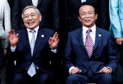 Haruhiko Kuroda, governor of the Bank of Japan, and Taro Aso, Japan's deputy prime minister and finance minister, Fukuoka, Japan 9 June 2019 (Photo: Reuters/Kim Kyung-Hoon)