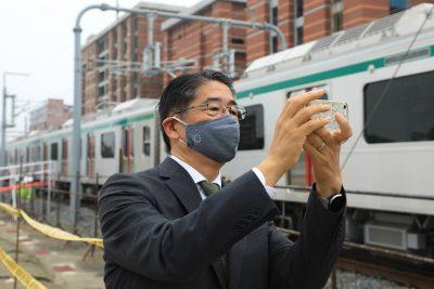 Japan's Ambassador to Bangladesh, Ito Naoki takes a selfie next to the metro rail at the Diabari depot Uttara. Bangladesh's first-ever metro rail train on its test run in Dhaka's Uttara (Photo: Md Manik/SOPA Images/Sipa USA/ Reuters).