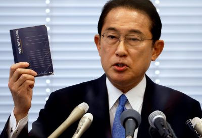 Fumio Kishida, Japan's ruling Liberal Democratic Party (LDP) lawmaker and former foreign minister, shows his notebook during a news conference as he announces his candidacy for the party's presidential election in Tokyo, Japan, 26 August 2021 (Photo: Reuters/Issei Kato).