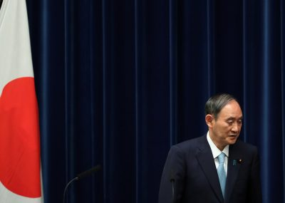 Japanese Prime Minister Yoshihide Suga leaves after a news conference at his office in Tokyo, Japan, 9 September 2021 (Photo: Reuters/Kim Kyung-Hoon/Pool).
