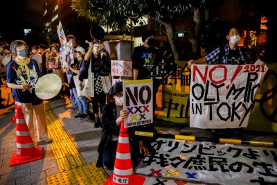 Anti-Olympic protesters flock in front of Japanese Prime Minister Yoshihide Suga's office, Tokyo, Japan, 29 July 2021 (Photo: Reuters/Androniki Christodoulou).