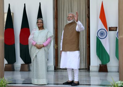 Indian Prime Minister Narendra Modi greets the media alongside his Bangladeshi counterpart Sheikh Hasina ahead of their meeting at Hyderabad House in New Delhi, India on October 5, 2019 (Photo: Reuters / Altaf Hussain).