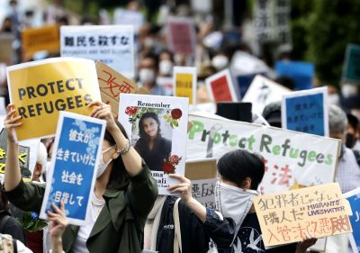 People opposing the revision of Japan's immigration control and refugee recognition law march in Tokyo, Japan, 16 May 2021 (Photo: Reuters/Kyodo).